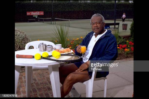Journalist and television presenter Trevor McDonald, best known for hosting ITN's News At Ten, photographed at a tennis club, circa 1995.