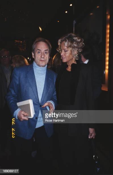 Journalist and writer Harold Evans with actress Farrah Fawcett at Robert Evans' 'The Week' seminar at Michael Jordan's Steak House New York City 2004