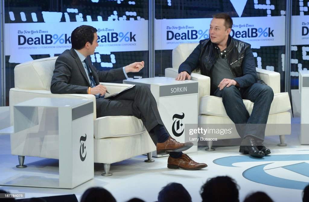 Journalist Andrew Ross Sorkin (L) and CEO & CTO of SpaceX and CEO & Chief Product Architect of Tesla Motors Elon Musk participate in a discussion at the New York Times 2013 DealBook Conference in New York at the New York Times Building on November 12, 2013 in New York City.