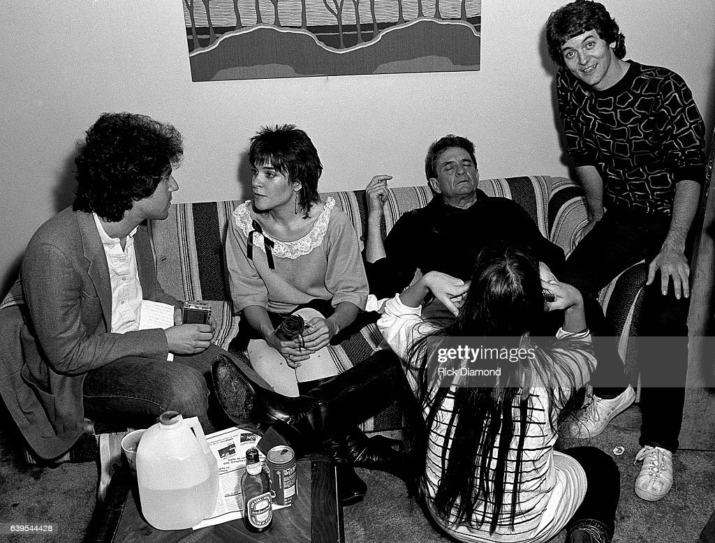 Journalist Andy Slater talks with Rosanne Cash, Johnny Cash and Rodney Crowell backstage after performing at The MoonShadow Saloon in Atlanta Georgia October 19, 1982