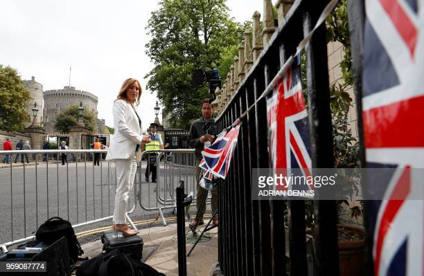 CNN journalist Anna Stewart prepares to make a live braodcast near Windsor Castle in Windsor west of London on May 16 as preparations continue ahead...