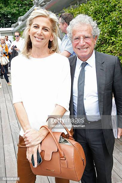 Journalist Anne Fulda and Laurent Dassault attend the 2016 French Tennis Open Day Six at Roland Garros on May 27 2016 in Paris France