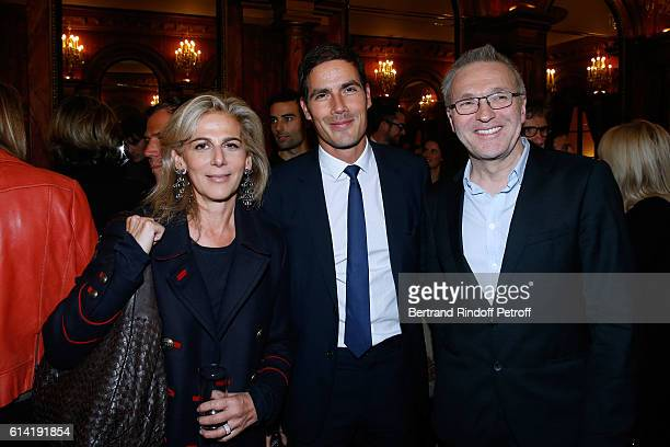 Journalist Anne Fulda CEO of Radio France Mathieu Gallet and Autor of the piece Laurent Ruquier attend the 'A Droite A Gauche' Theater Play at...