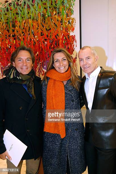Journalist AnneClaire Coudray standing between her companion Nicolas Vix and Stylist JeanClaude Jitrois attend the Guerlain collaboration with...
