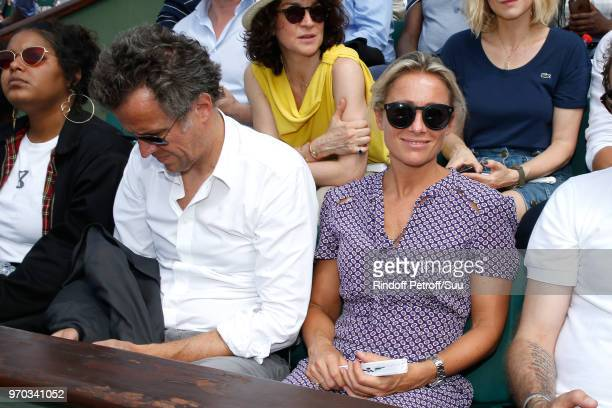 Journalist AnneSophie Lapix and her husband Arthur Sadoun attend the Women Final of the 2018 French Open Day Fourteen at Roland Garros on June 9 2018...