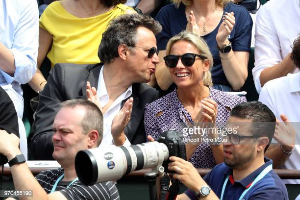 Journalist AnneSophie Lapix and her husband Arthur Sadoun attend the 2018 French Open Day Fourteen at Roland Garros on June 9 2018 in Paris France