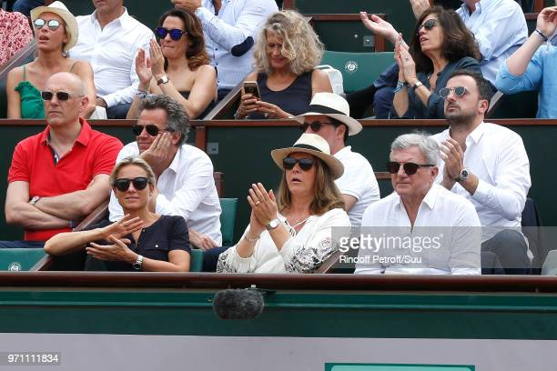 Journalist AnneSophie Lapix her husband Arthur Sadoun Sidney Toledano and his son Alan Toledano attend the Men Final of the 2018 French Open Day...