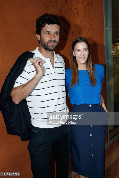 Journalist Antoine Benneteau and actress Charlotte Gabris attend the 2018 French Open Day Ten at Roland Garros on June 5 2018 in Paris France