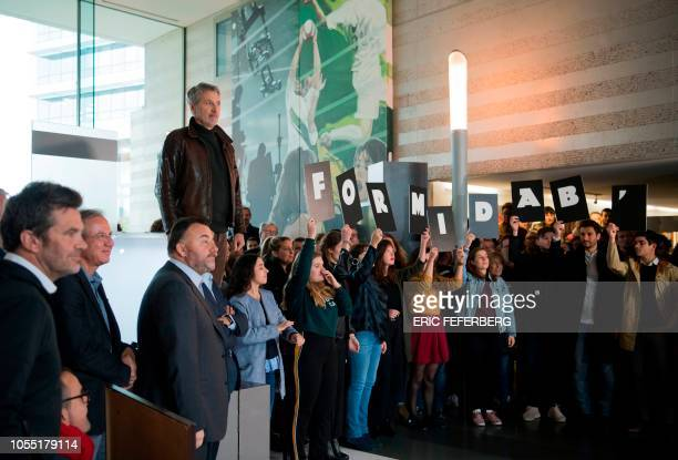 Journalist Antoine de Caunes and the staff of French TV channel Canal + stand inside Canal+ headquarters on October 29, 2018 in Boulogne-Billancourt...