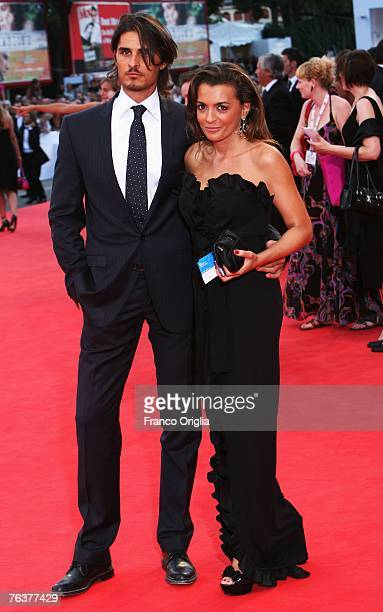 Journalist Antonia De Mita and unidentified guest attend the opening ceremony and the Atonement Premiere on day 1 of the 64th Annual Venice Film...