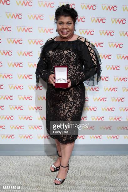 Journalist April Ryan poses with the WMC She Persisted Award at the Women's Media Center 2017 Women's Media Awards at Capitale on October 26 2017 in...