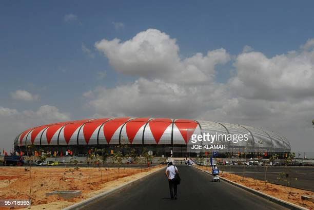 A journalist arrives to watch a match of the African Cup of Nations football championships CAN2010 between Algeria and Malawi at November 11 stadium...