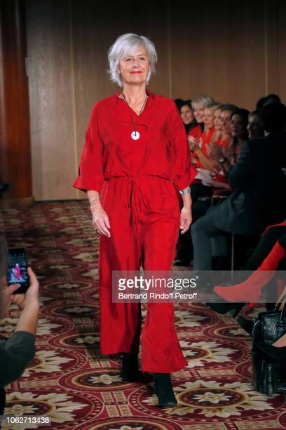 Journalist at BFM Business Annie Lemoine dressed by Reality Studio walks the runway during the 'Sauvez le Coeur des Femmes Red Defile' Show at Hotel...