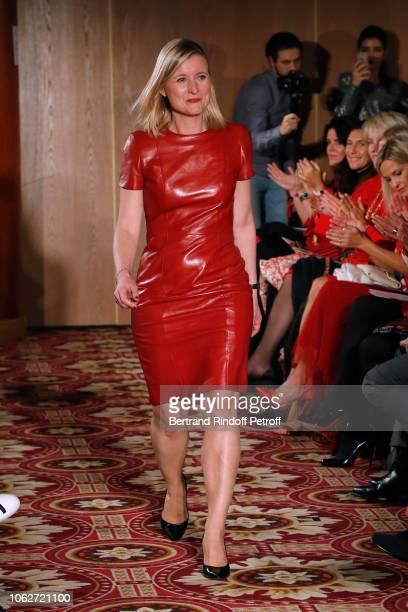 "Journalist at BFMTV Karine de Menonville, dressed by Paule Ka, walks the runway during the ""Sauvez le Coeur des Femmes - Red Defile"" Show at Hotel..."