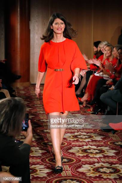 Journalist at LCI Magali Lunel dressed by Tibi walks the runway during the Sauvez le Coeur des Femmes Red Defile Show at Hotel Marriot on November 16...