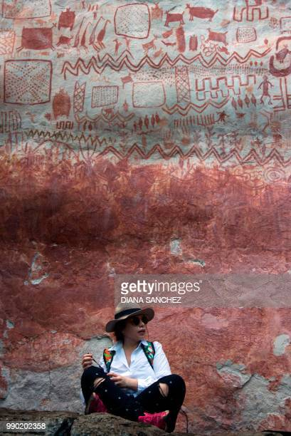 A journalist at the Cerro Azul in Serrania La Lindosa which had been declared Protected Archaeological Site of Colombia last May in the Amazonian...