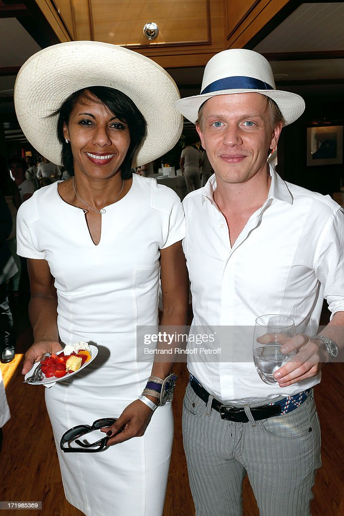 Journalist Audrey Pulvar and actor Alex Luz attend 'Brunch Blanc' hosted by Groupe Barriere for Sodexho with a cruise in Paris on June 30, 2013, France.