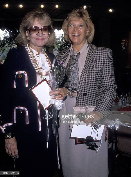 TV journalist Barbara Walters and TV personality Dinah Shore attend the Saks Fifth Avenue's Adolfo Fashion Show and The Colleagues Valentine's Day...