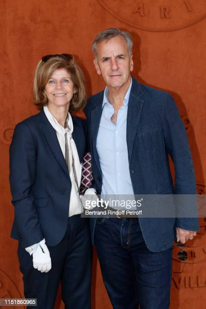 Journalist Bernard de La Villardiere and his wife Anne attend the 2019 French Tennis Open Day One at Roland Garros on May 26 2019 in Paris France