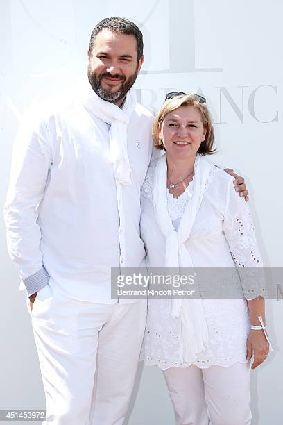 Journalist Bruce Toussaint and his wife Catherine attend the 'Brunch Blanc' hosted by Barriere Group Held on Yacht 'Excellence' on June 29 2014 in...