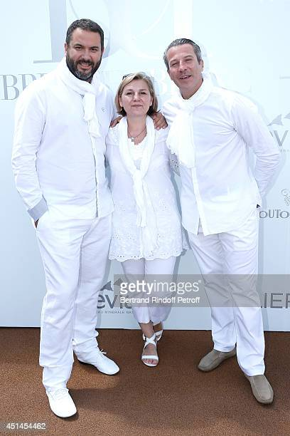 Journalist Bruce Toussaint his wife Catherine and General Manager at Paris Hotel Fouquet's Barriere Fabrice Moizan attend the 'Brunch Blanc' hosted...