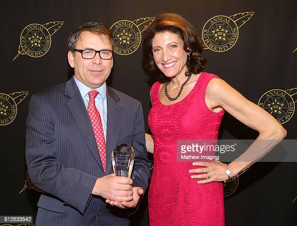 Journalist Bryan Alexander, winner of the press award, and Amy Aquino pose backstage at the 53rd Annual ICG Publicists Awards at The Beverly Hilton...