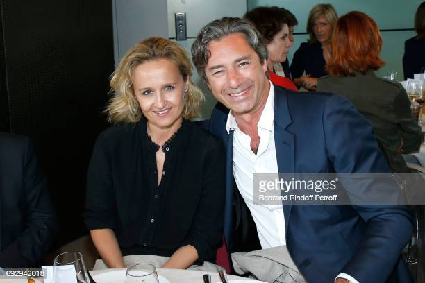 Journalist Caroline Roux and her companion General Director of Facebook France Laurent Solly attend the France Television Lunch during the 2017...