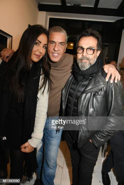 Journalist Chirelle Amozig Samy Naceri and producer/director Jacques Cohen Bacry attend 'Bagel N Fries' Restaurant Opening Party on November 28 2017...