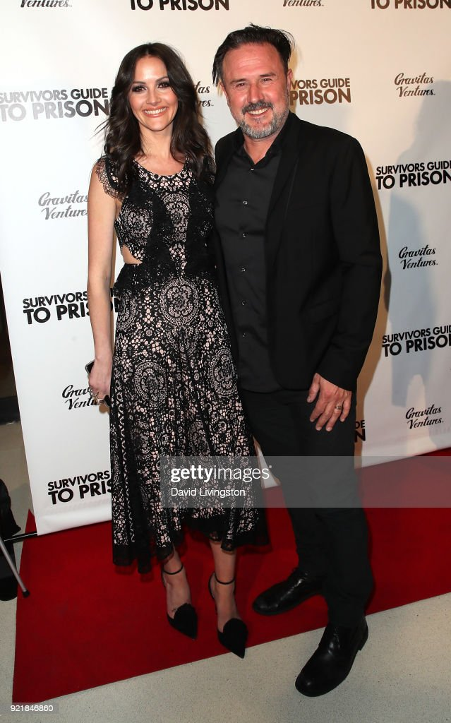 Journalist Christina McLarty (L) and husband actor David Arquette attend the premiere of Gravitas Pictures' 'Survivors Guide to Prison' at The Landmark on February 20, 2018 in Los Angeles, California.
