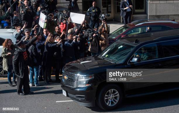 Journalist cover Gen Michael Flynn former national security adviser to US President Donald Trump as he leaves Federal Court in Washington DC December...