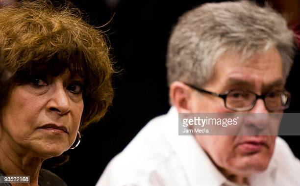 Journalist Cristina Pacheco and writer Jose Emilio Pacheco listens during a conference in his honor after winning the Cervantes prize at the Expo...