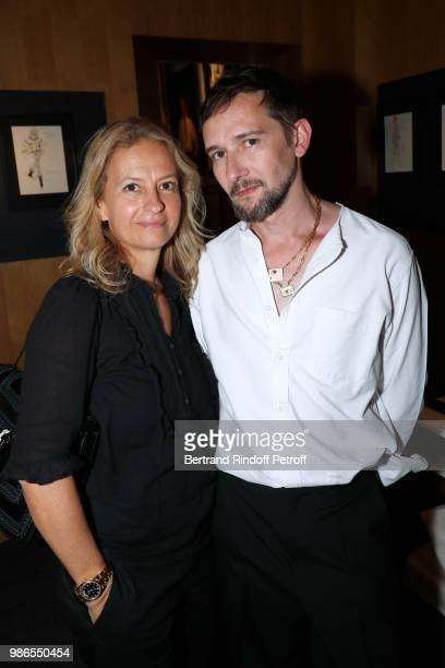 Journalist Delphine Perroy and Samuel Francois attend the Tan Giudicelli Exhibition of drawings and accessories preview at Galerie Pierre Passebon on...
