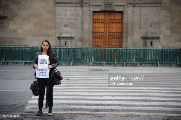 A journalist demands justice for slain Mexican journalist Salvador Adame Pardo during a demonstation at Zocalo Square in front of the National Palace...