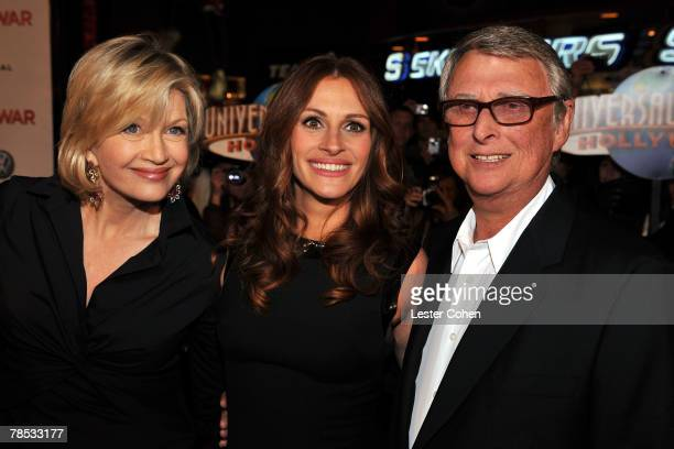 Journalist Diane Sawyer actress Julia Roberts and director Mike Nichols arrive to the premiere of Universal Pictures' Charlie Wilson's War at City...