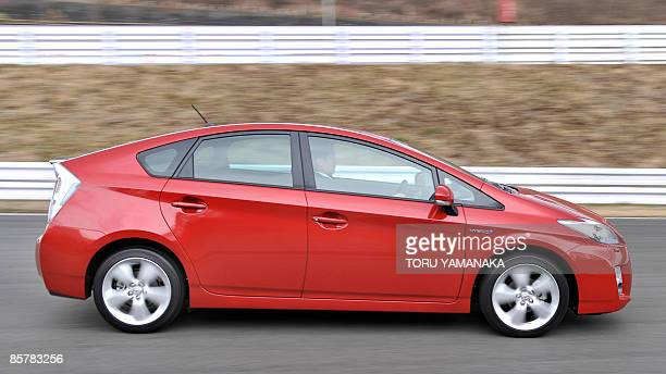 Journalist drives a prototype of Toyota's new hybrid vehicle Prius during a test drive event at Fuji Speedway in Oyama, 100km west of Tokyo, on March...