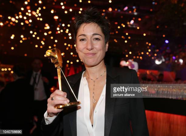 TV journalist Dunja Hayali poses during the party of the 51st GoldenCamera Awards in Hamburg Germany 6 February 2016 Hayali won the award in the...