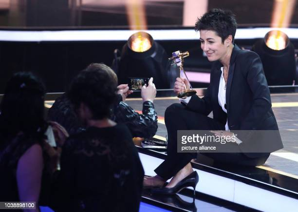 Journalist Dunja Hayali poses with her award on stage after the 51st GoldenCamera Award in Hamburg Germany 6 February 2016 Hayali was awarded in the...