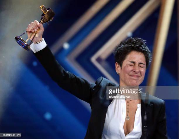 Journalist Dunja Hayali poses with her award on stage during the 51st GoldenCamera Award in Hamburg Germany 6 February 2016 Hayali was awarded in...