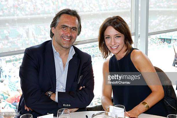 Journalist Emmanuel Chain and TV Host Virginie Guilhaume attend the 2015 Roland Garros French Tennis Open Day Six on May 29 2015 in Paris France