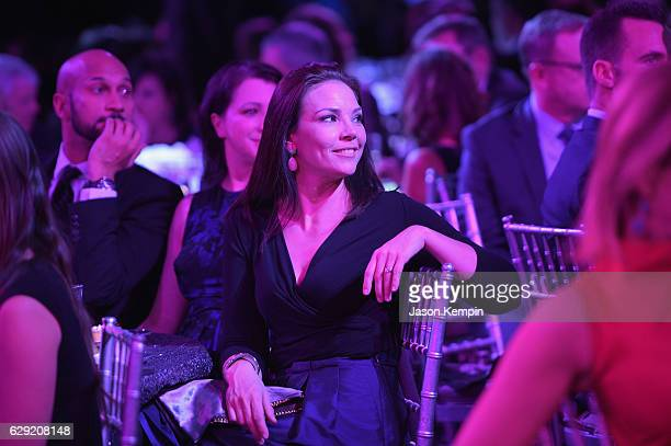 Journalist Erica Hill watches the show during the CNN Heroes Gala 2016 at the American Museum of Natural History on December 11 2016 in New York City...