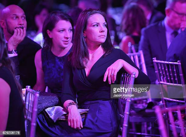 Journalist Erica Hill watches the show during the CNN Heroes Gala 2016 at the American Museum of Natural History on December 11, 2016 in New York...