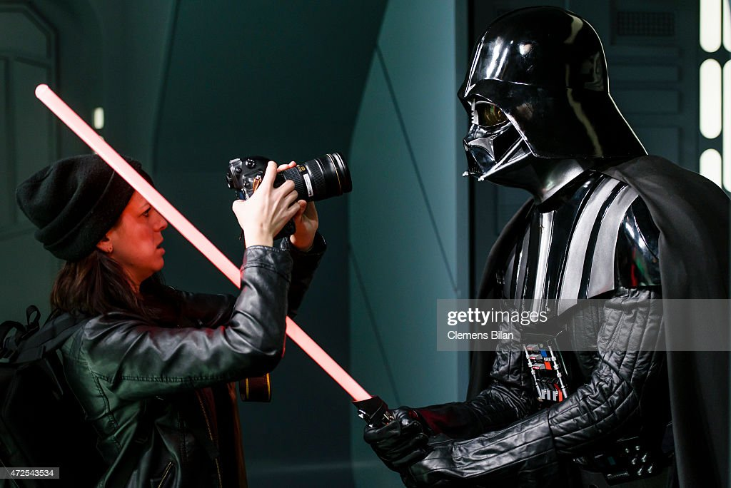 A journalist films a wax figure of the Star Wars character Darth Vader displayed on the occasion of Madame Tussauds Berlin Presents New Star Wars Wax Figures at Madame Tussauds on May 8, 2015 in Berlin, Germany.