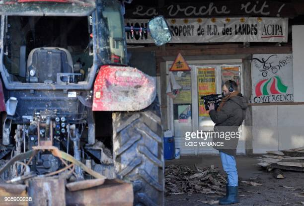A journalist films with a video camera in La Vache rit a farm in the 'Zad' of NotreDamedesLandes on January 17 2018 in NotreDamedesLandes outside...