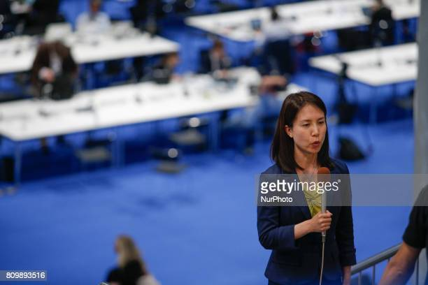 A journalist for Japanese television is seen working at the press center in the Hamburg Messe on 6 July 2017 ahead of the 2017 G20 meeting