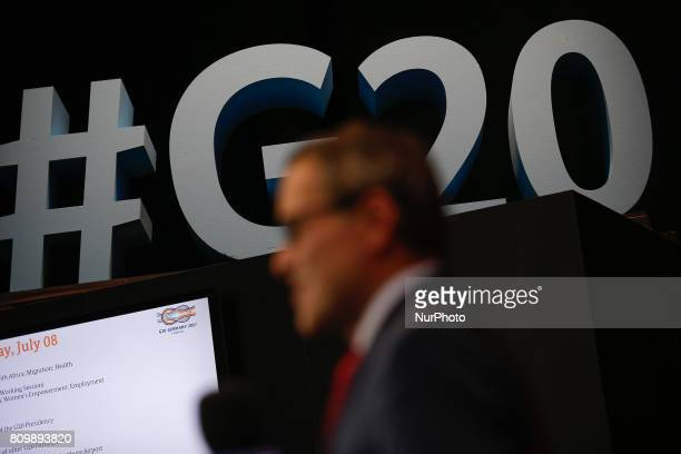 A journalist for the Polish TVN station is seen in front of a G20 hashtag sign on 6 July 2017 Starting 7 July the leaders of the world's top 20...