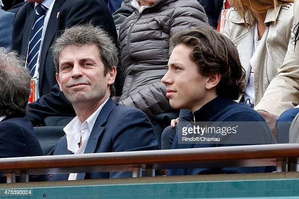 Journalist Frederic Taddei and Guest attend the 2015 Roland Garros French Tennis Open Day Eight on May 31 2015 in Paris France
