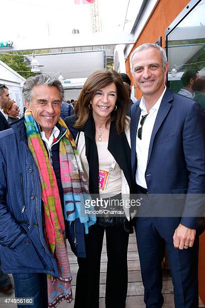 Journalist Gerard Holtz Framboise Holtz and former football player Alain Roche attend the 2015 Roland Garros French Tennis Open Day Five on May 28...