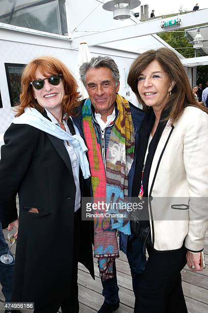Journalist Gerard Holtz standing between his wife Muriel Mayette and his ex wife Framboise Holtz attend the 2015 Roland Garros French Tennis Open Day...