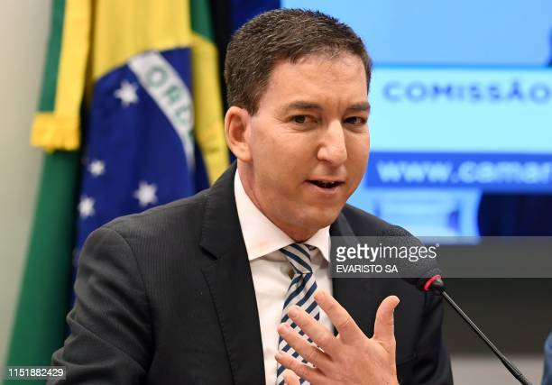 US journalist Glenn Greenwald founder and editor of The Intercept website gestures during a hearing at the Lower House's Human Rights Commission in...