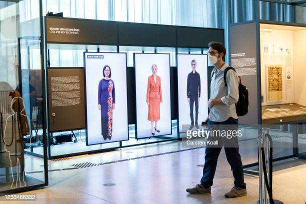 Journalist goes to an exhibit wall in the Loss and New Beginnings section in the new Documentation Center for Displacement, Expulsion and...